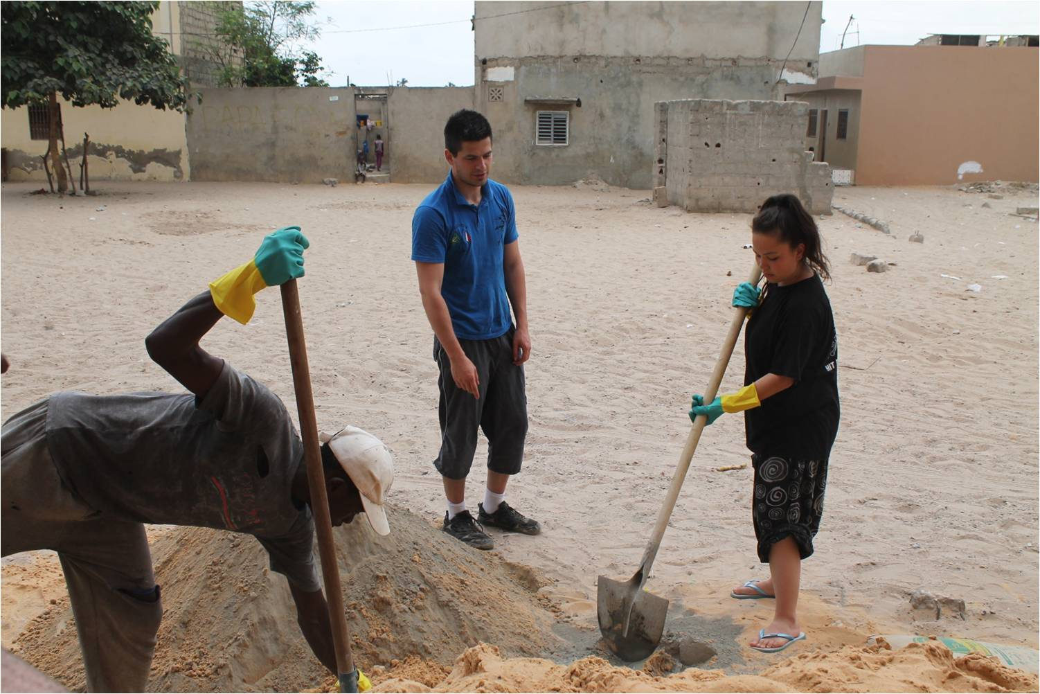 Gilsun and Mishio making concrete